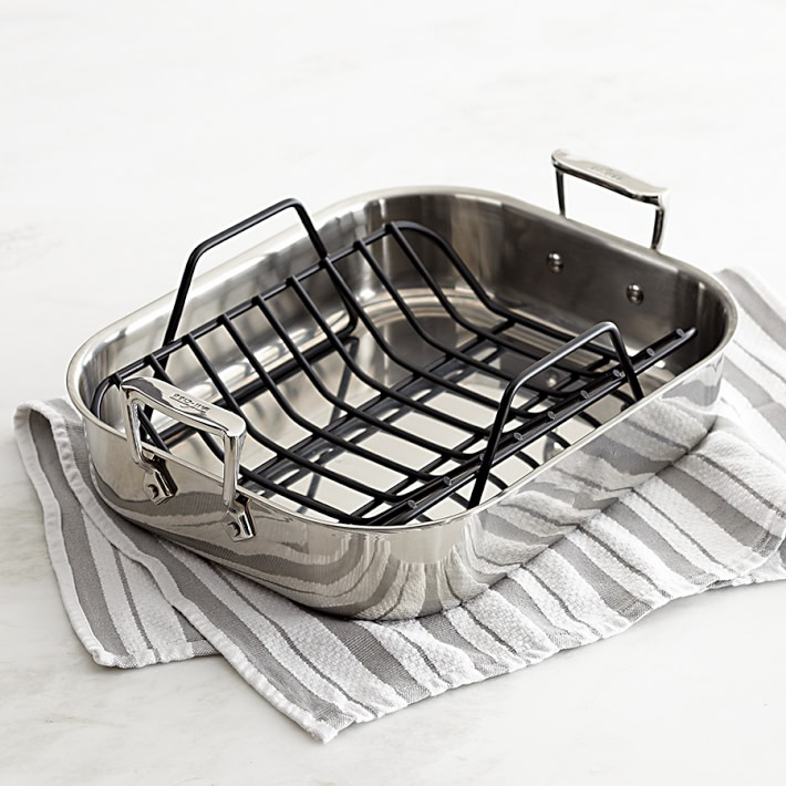 A roasting pan placed on a hand towel.