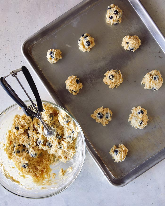 Blueberry yogurt cookies scooped onto a baking sheet.