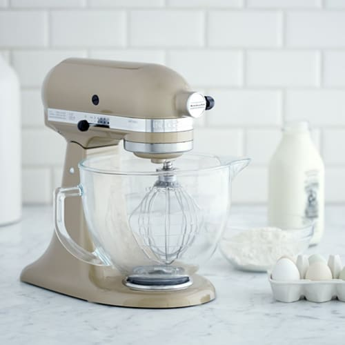 Tan stand up mixer with milk and eggs.