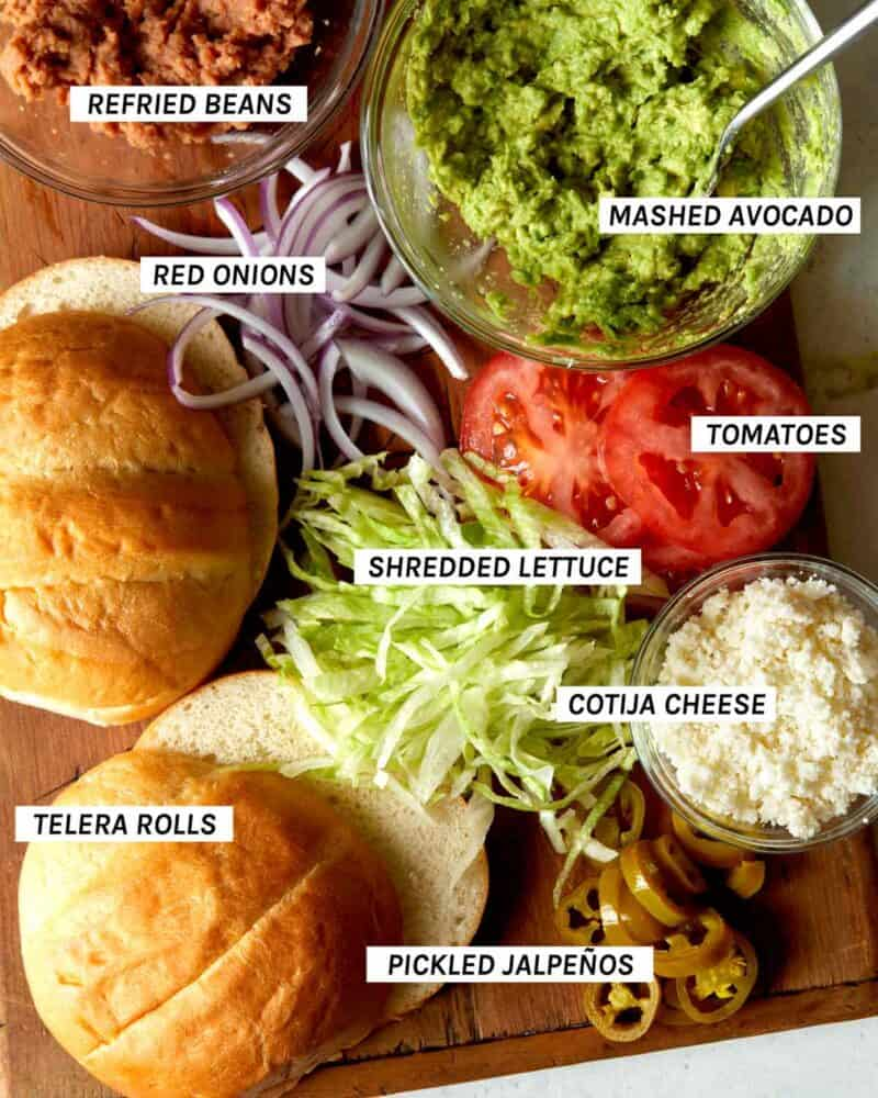 An image showing all the sandwich toppings for a carne asada torta.