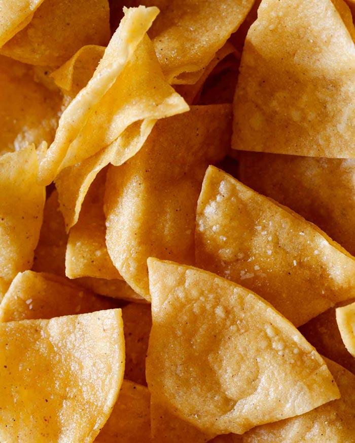 A close up of tortilla chips.