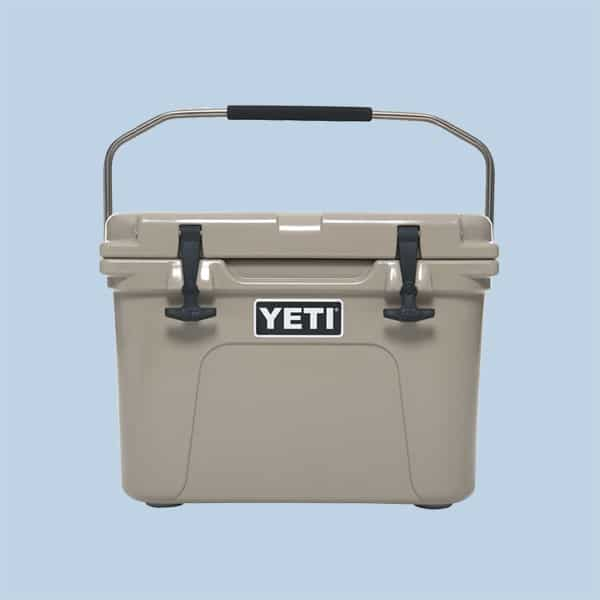 A yeti roadie cooler on a light blue background.