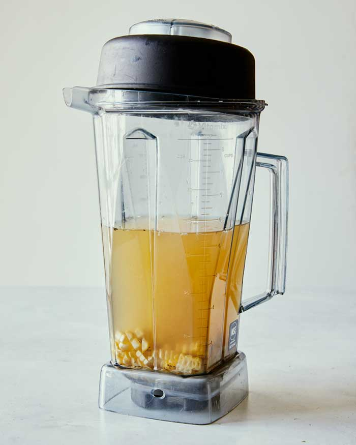 Corn kernels in stock in a blender to be blended.