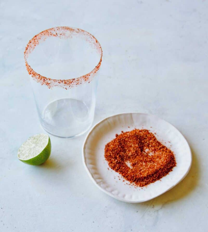 Chili lime seasoning on a plate to show how you rim a glass with it.