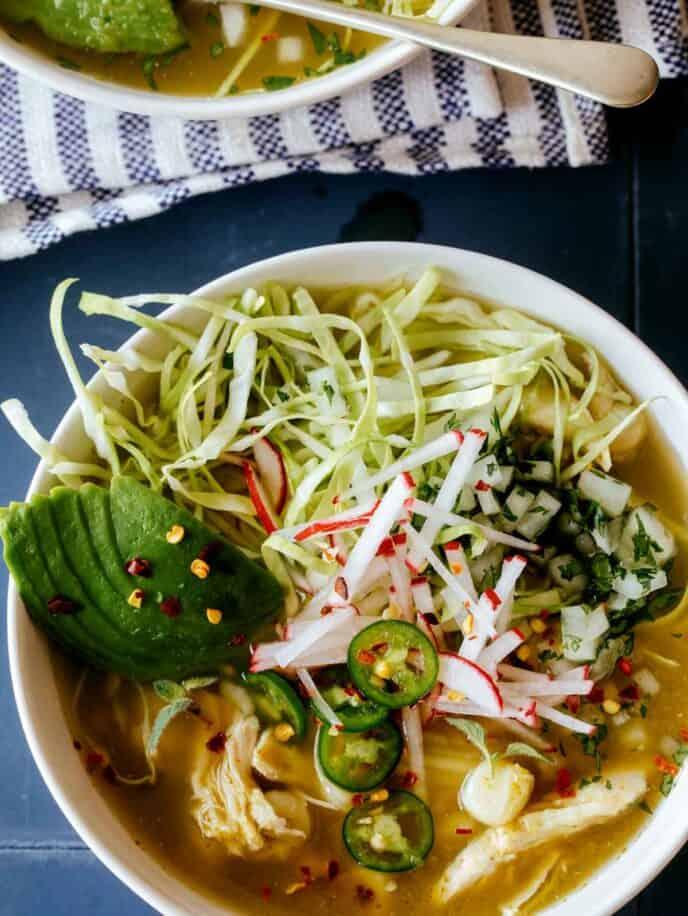 A close up of a bowl of pozole verde de pollo.