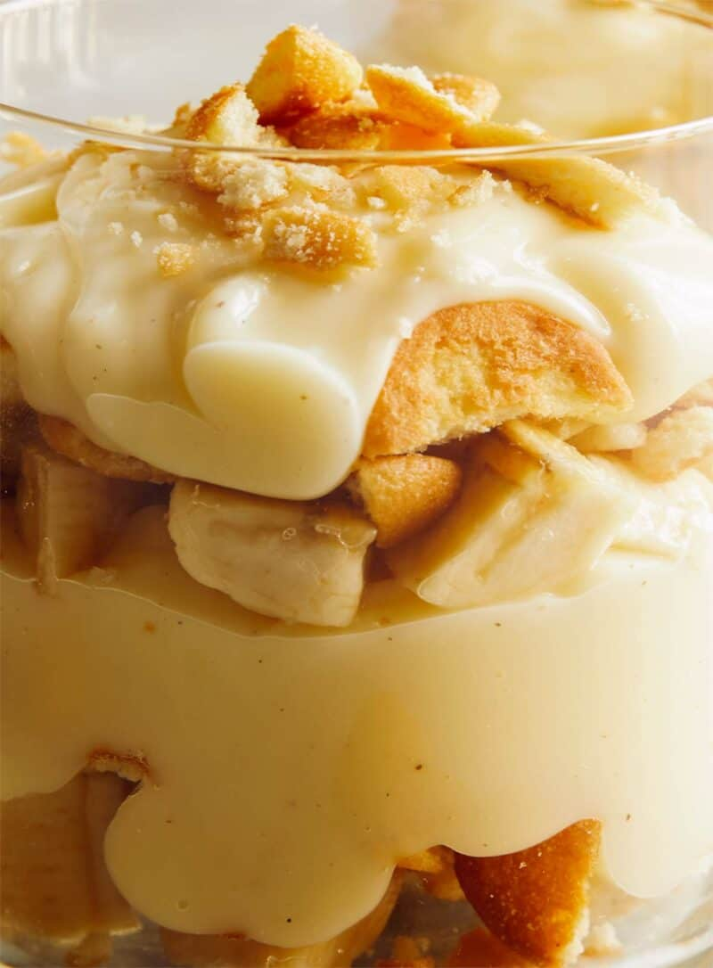 A close up on the side of a glass cup that shows the layers of banana pudding.