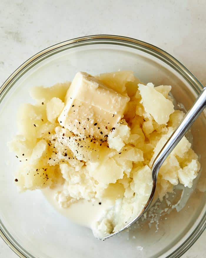Mashed potatoes with butter and cream and salt and pepper on a bowl.