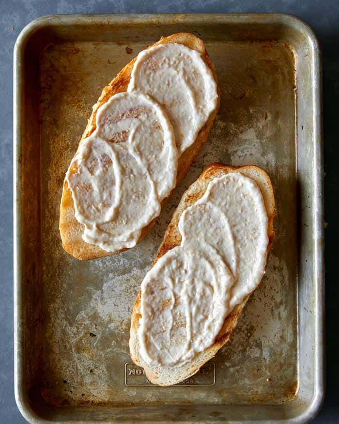 Spread horseradish sauce onto grilled ciabatta rolls.