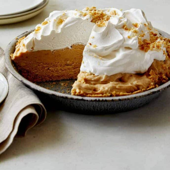 Creamy No Bake Peanut Butter Pie close up with a slice taken out so you can see the inside.