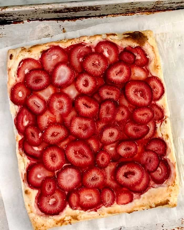 A simple strawberry tart out of the oven baked.