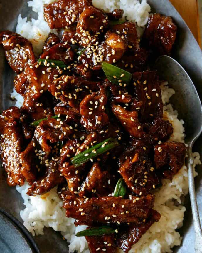 Close up shot of Mongolian Beef over rice.