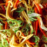 Close up on chow mein noodles so you can see the ingredients.