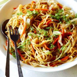 A close up of Chow Mein Noodles being served on a platter.