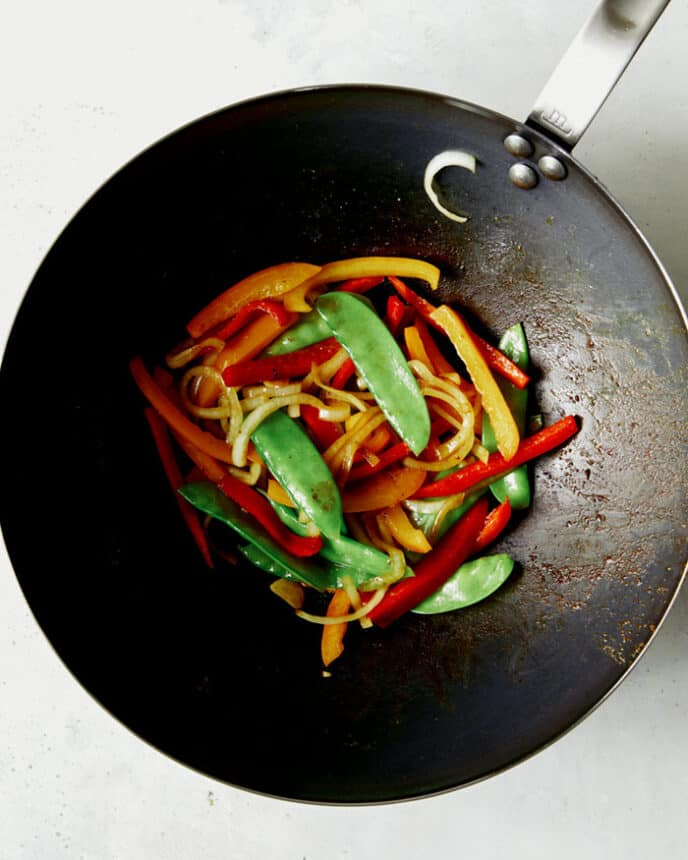 Vegetables cooked in a wok.