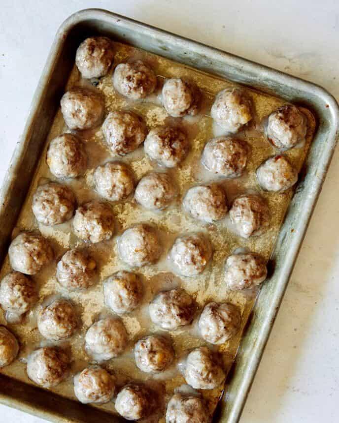 Swedish meatballs baked on a baking sheet.