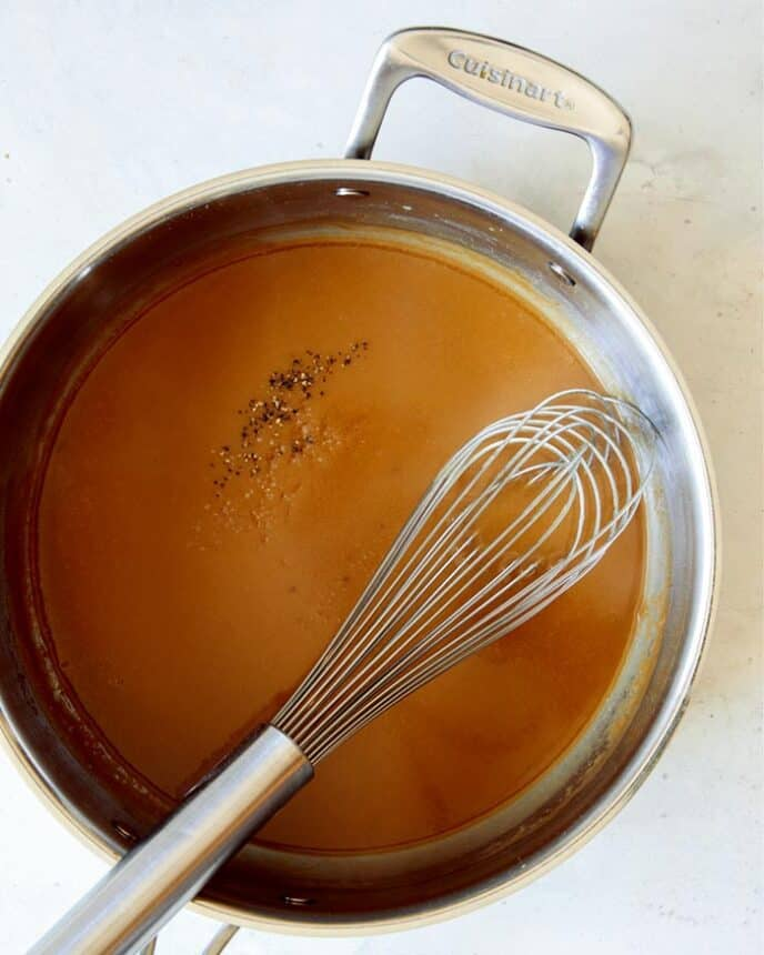 Gravy made in a skillet for Swedish Meatballs with a whisk.