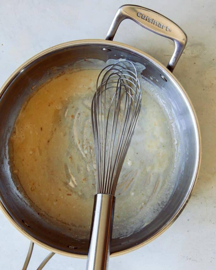 Melted butter and flour in a skillet to make gravy.