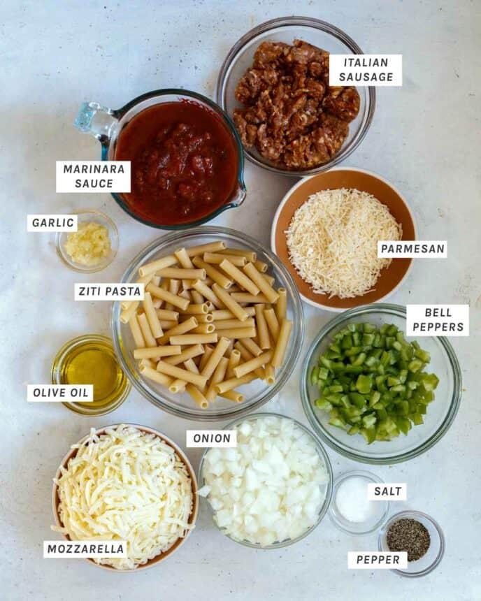 Baked Ziti ingredients laid out and labeled on a kitchen counter.