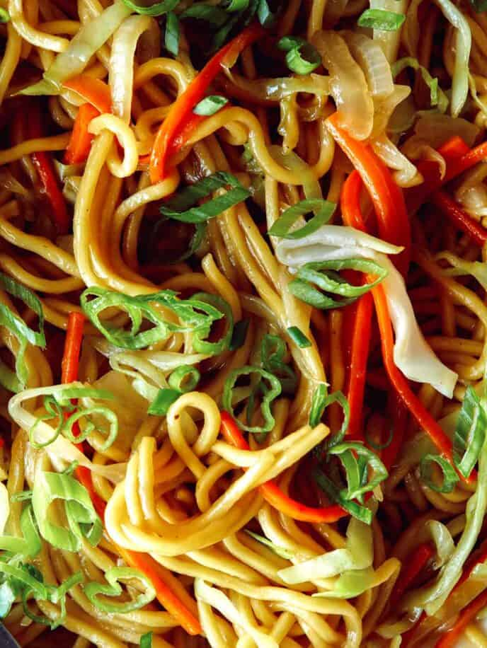 A close up on chow mein noodles to show all the ingredients like peppers and carrots.