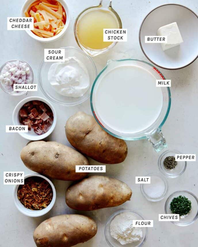 Ingredients to make Loaded Baked Potato Soup laid out on a kitchen counter.