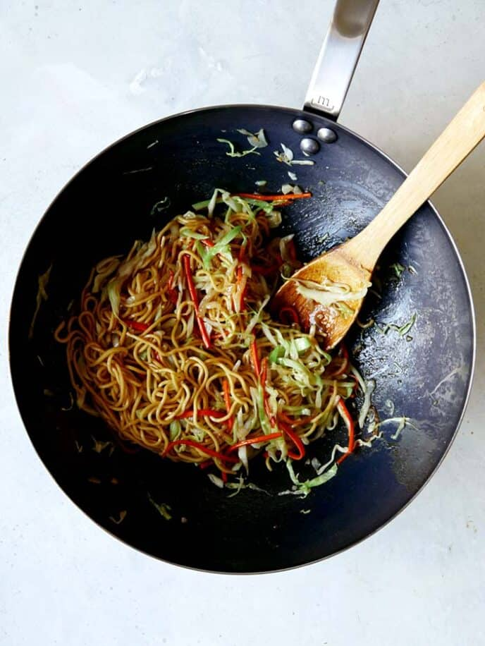 Chow Mein in a wok tossed together with the Chow Mein Sauce.