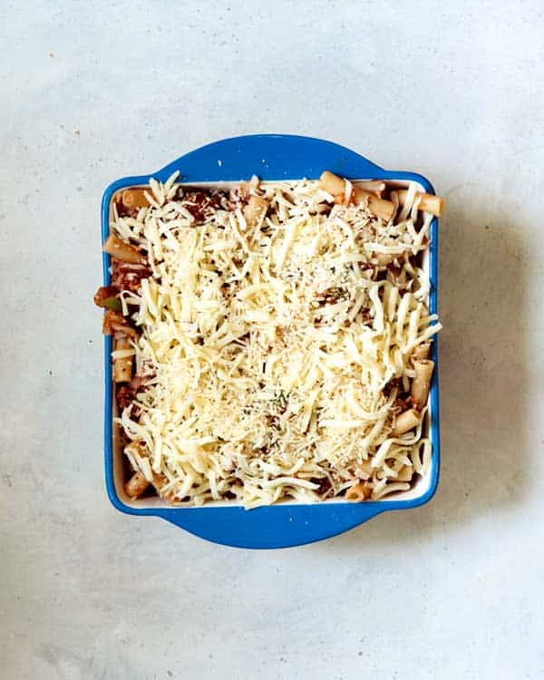 Baked ziti in a baking dish ready for the oven.