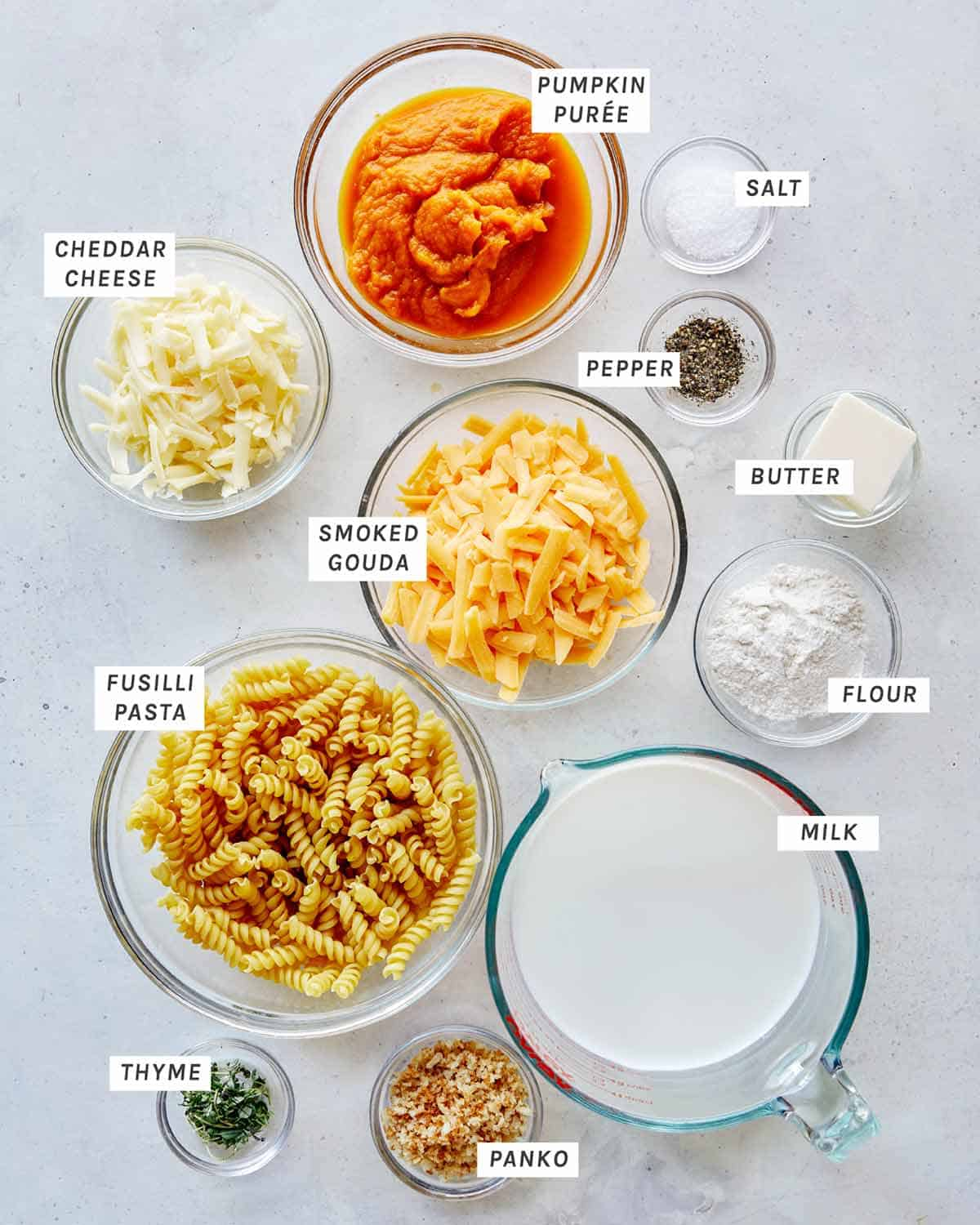 Ingredients for Pumpkin Mac and Cheese all laid out on a kitchen counter.