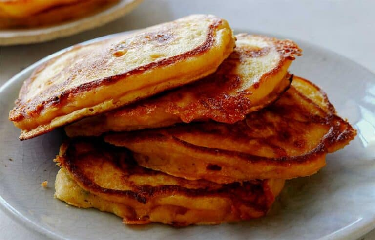 A platter of freshly made cheesy pumpkin pancakes.
