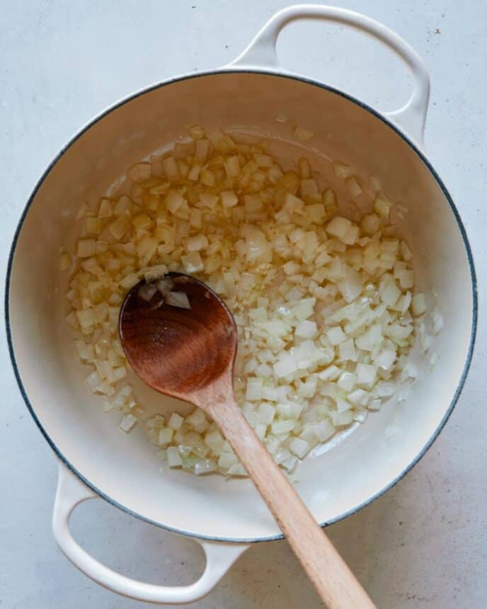 Sautéd onion and garlic in a pot.