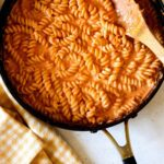 A skillet full of vodka sauce and pasta.