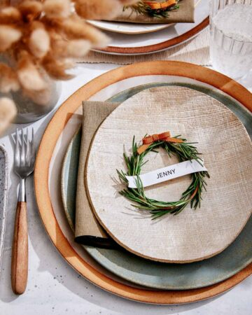 Rosemary Wreath Place Card on a plate in a table setting.