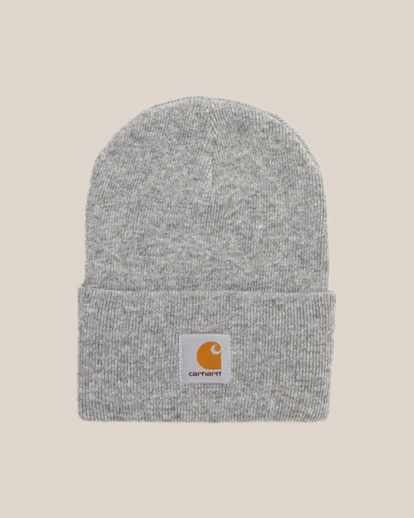 A gray beanie on a tan background.