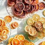 Various typed of dehydrated citrus wheels on a plates.