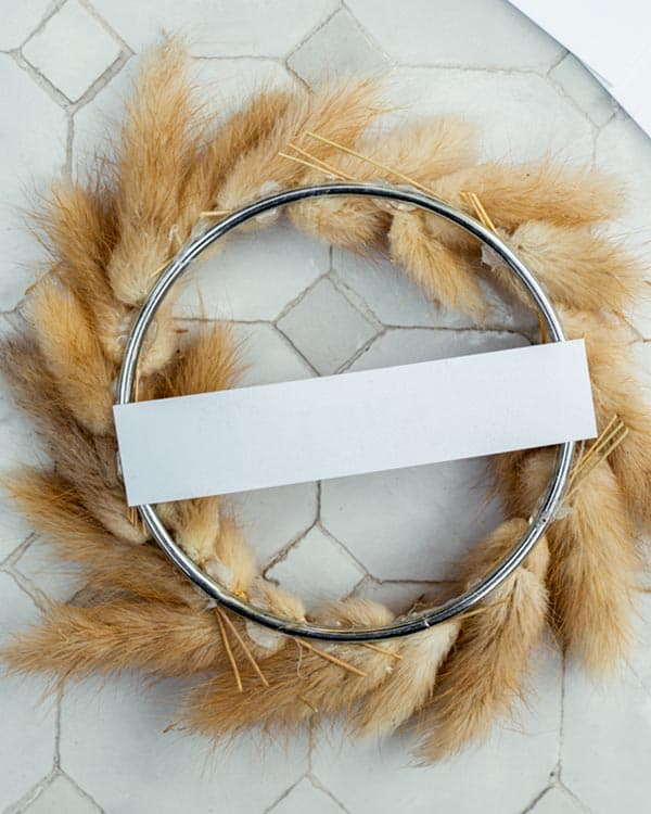 The back view of a mini wreath place card.