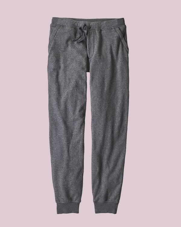 Gray sweat pants on a pink background.