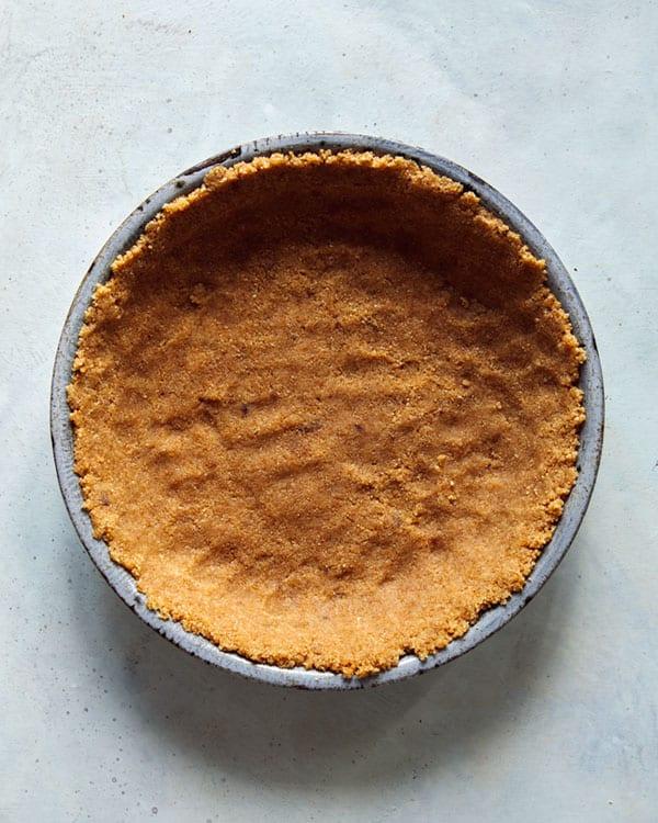 French silk pie crust pressed into a pie dish.