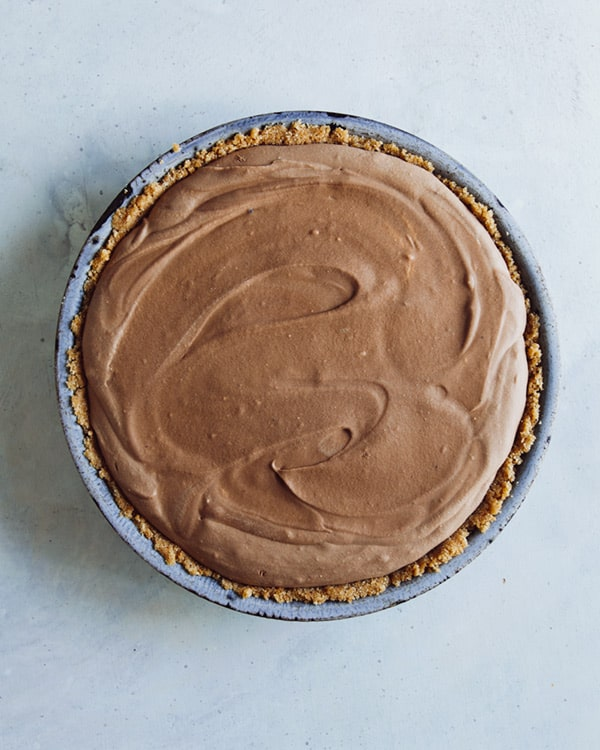 A freshly set french silk pie on a kitchen counter.