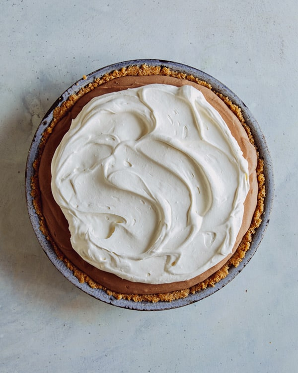 Whipped cream on top of french silk pie.