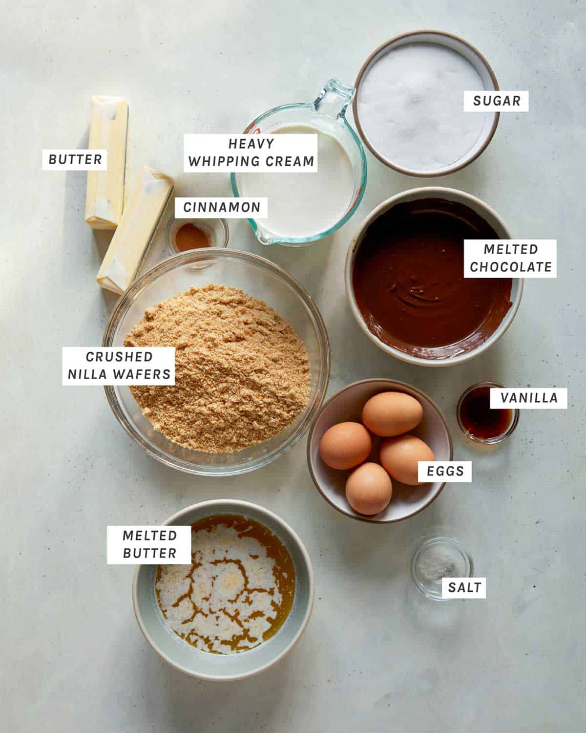 French silk tart ingredients all arranged on a kitchen counter.