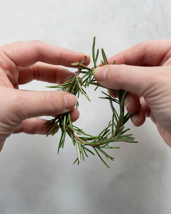 Making a rosemary wreath.