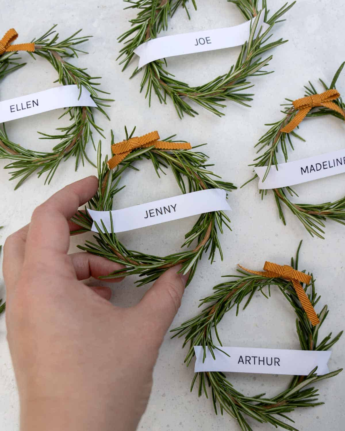 Rosemary wreaths all laid out on a surface.
