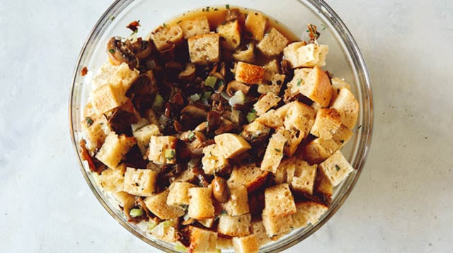 A bowl of stuffing on a kitchen counter.