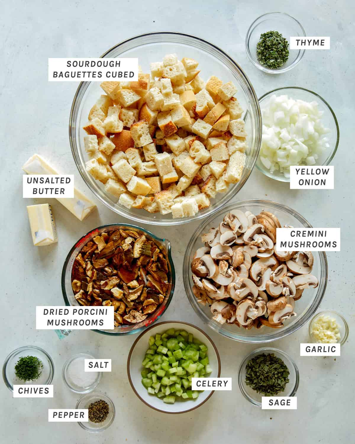 Ingredients for mushroom and sage stuffing on a kitchen counter.