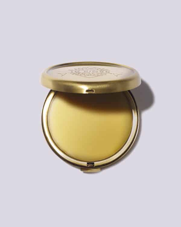 A compact of solid perfume.
