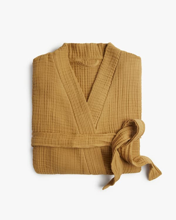 A mustard colored linen yellow robe.