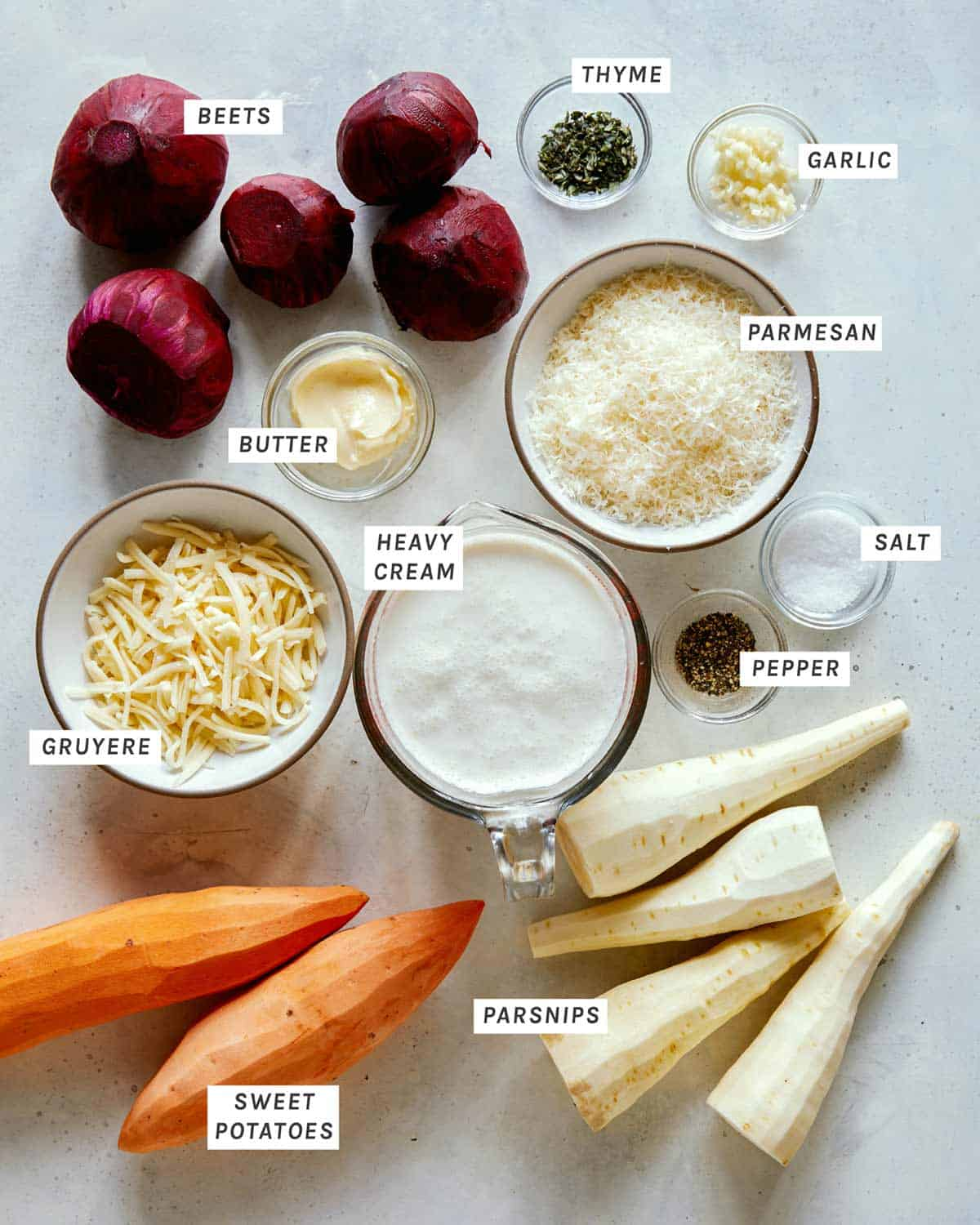 Ingredients for our Cheesy Root Vegetable Gratin on a kitchen counter.