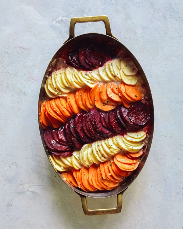 A baking dish with root vegetable gratin.