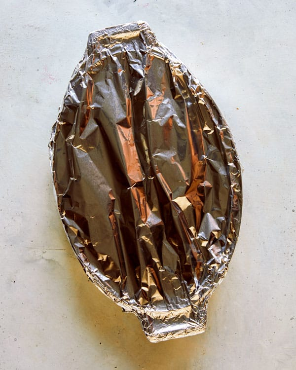 A baking dish covered with tin foil to go into the oven.