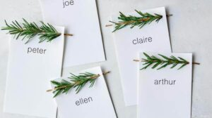 Rosemary Sprig Place Cards laid out on a surface.
