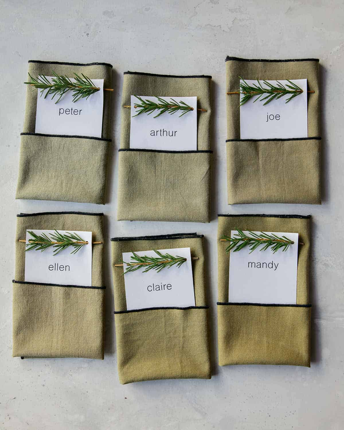 Rosemary Sprig Place Cards tucked into napkins.